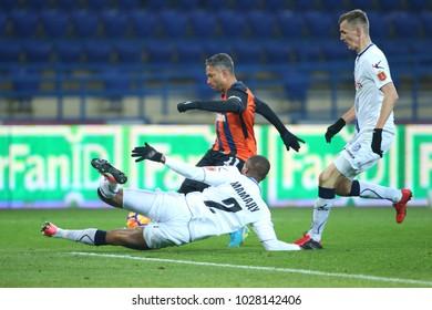 KHARKIV, UKRAINE - FEBRUARY 16, 2018: Tackle by Mamadou Wague trying block the shot by Marlos Romero Bonfim. Shakhtar Donetsk vs FC Chernomorets
