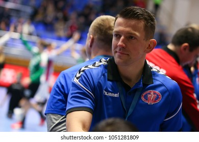 KHARKIV, UKRAINE - FEBRUARY 24, 2018: HC Motor Zaporozhye head coach ROMBEL Patryk close-up smiling portrait. EHF Men's Champions League Group Phase HC Motor Zaporozhye - Skjern Handbold