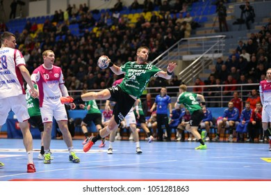 KHARKIV, UKRAINE - FEBRUARY 24, 2018: Dramatic diving jump shot by MYRHOL Bjarte Hakon. EHF Men's Champions League Group Phase HC Motor Zaporozhye - Skjern Handbold