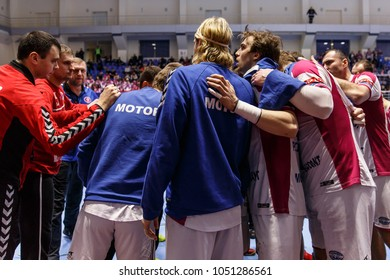 KHARKIV, UKRAINE - FEBRUARY 24, 2018: HC Motor Zaporozhye players and coaches staying together in energetic circle before the game. EHF Men's Champions League Group Phase HC Motor Zaporozhye - Skjern