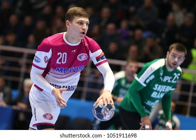 KHARKIV, UKRAINE - FEBRUARY 24, 2018: KOZAKEVYCH Artem close-up portrait, runs and dribbles with the ball. EHF Men's Champions League Group Phase HC Motor Zaporozhye - Skjern Handbold