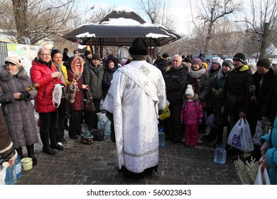 KHARKIV, UKRAINE - JANUARY 19, 2017: People came to creek to be sanctified and to consecrate water and to bathe in the icy creek during the celebration of the Orthodox Epiphany in Sarzhin Ravine park.
