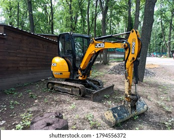 KHARKIV, UKRAINE JULY 1, 2020: Backhoe Loader Jcb in the park. The new 8026 CTS mini excavator is the first JCB machine with a standard rear extension in the 2.5 to 3.5 ton class.