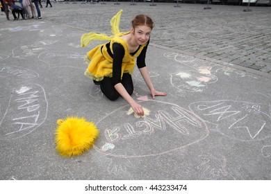 Kharkiv, Ukraine - June 1, 2016: Chalk drawing flashmob during Children's Day at the main square of Kharkiv city, Freedom Sq.