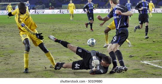 KHARKIV, UKRAINE - MARCH 24: Papa Gueye (L) FC Metalist (Kharkiv) defender in action at match vs FC Chernomorets (Odesa) (5:1), March 24, 2010 in Kharkov, Ukraine