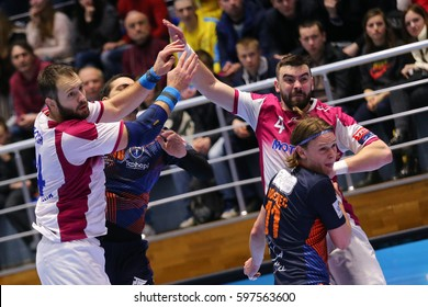"KHARKIV, UKRAINE - MARCH 4, 2017: DOROSHCHUK Dmytro and BUINENKO Evgeniy in defense. EHF Men's Champions League match HC Motor Zaporozhye vs Montpellier HB, Palace of Sports ""Lokomotiv"""