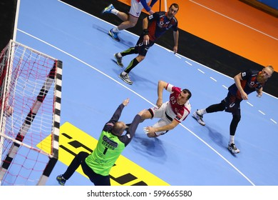 "KHARKIV, UKRAINE - MARCH 4, 2017:  SHELMENKO Sergey scores. Top view. EHF Men's Champions League match HC Motor Zaporozhye vs Montpellier HB, Palace of Sports ""Lokomotiv"""
