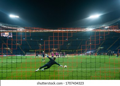 Kharkiv, Ukraine - March 4, 2020: Goalkeeper in gates jumping to catching ball before match UPL Shakhtar - Dnipro-1