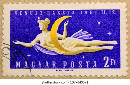 KHARKIV, UKRAINE - MARCH 5, 2018: Post stamp of Hungary depicting space woman, of series dedicated to the Venus space probe.