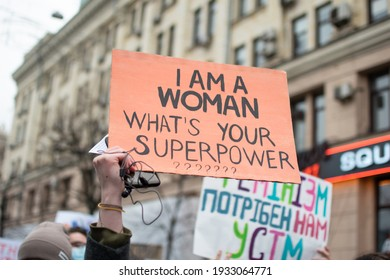 """Kharkiv, Ukraine – March 8, 2021: Poster saying """"I'M A WOMAN. WHAT'S YOUR SUPERPOWER?"""""""