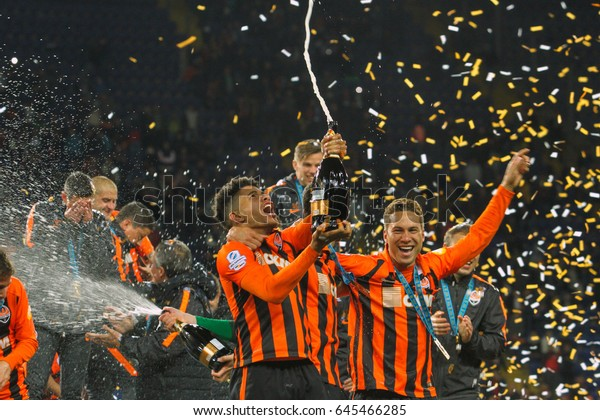 KHARKIV, UKRAINE – MAY, 17: The players of FC Shakhtar champagne celebrating victory in final match of the Cup of Ukraine Shakhtar (Donetsk) - Dynamo (Kyiv) at the Metalist Stadium May 17, 2017