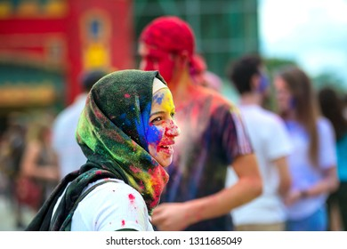 Kharkiv, Ukraine - May 19, 2018: Crowd of people celebrating Holi festival of colors in the cenral park of the town