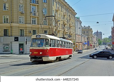 KHARKIV, UKRAINE - MAY 2 - A red Tatra T3 tram passing through Moskovskyi Prospekt in the centre of Kharkiv on May 2, 2017 in Kharkiv (Kharkov), Ukraine