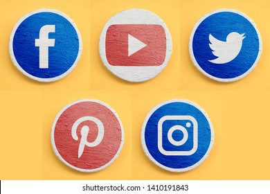 Kharkiv, Ukraine - May, 24, 2019 Set of main social networks icons for web site or mobile application. Realism design concept. Red and blue painted symbols on white texture coating round surface