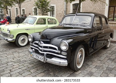 KHARKIV, UKRAINE - MAY 31, 2015: Exhibition of vintage cars on the Freedom Square in Kharkiv, May 31, 2015