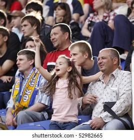 KHARKIV, UKRAINE - MAY 9: Young FC Metalist fan cheering her team during FC Metalist (Kharkiv) vs. FC Arsenal (Kyiv) (1:0) soccer match, May 9, 2010 in Kharkov, Ukraine