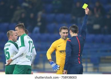 KHARKIV, UKRAINE - NOVEMBER 17, 2017: Referee shows yellow card to Yuri Pankiv. Shakhtar Donetsk vs FC Oleksandriya