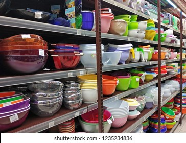 KHARKIV, UKRAINE - NOVEMBER 20, 2018: Wide selection of houseware, kitchenware, different types and colors of bowls on shelves at the supermarket.