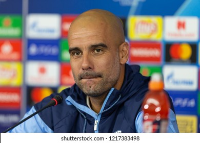 KHARKIV, UKRAINE - OCT 22, 2018: Head coach Josep Pep Guardiola smiling with sceptic. Beautiful close-up portrait. UEFA Champions League press-conference Shakhtar-Manchester City.