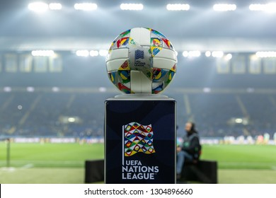 KHARKIV, UKRAINE - OCTOBER 16, 2018: Adidas Nations League, official match ball of UEFA Nations League  on stand. Beautiful stadium lights on background. Ball has colorful design elements with flags
