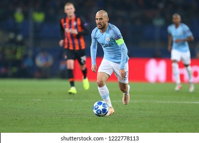 KHARKIV, UKRAINE - OCTOBER 22, 2018: David Silva beautiful portrait. Runs quickly with ball, fast impressive spectacular dribbling. UEFA Champions League Shakhtar-Manchester City.