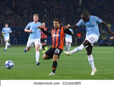KHARKIV, UKRAINE - OCTOBER 23, 2018: Benjamin Mendy of Manchester City (R) kicks a ball during the UEFA Champions League game against Shakhtar Donetsk at OSK Metalist stadium. ManCity won 3-0