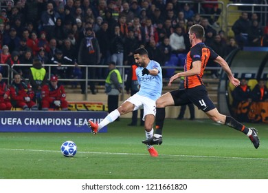 KHARKIV, UKRAINE - OCTOBER 23, 2018: Riyad Mahrez of Manchester City (L) kicks a ball during the UEFA Champions League game against Shakhtar Donetsk at OSK Metalist stadium in Kharkiv. ManCity won 3-0