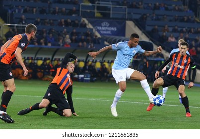 KHARKIV, UKRAINE - OCTOBER 23, 2018: Gabriel Jesus of Manchester City (C) fights for a ball with Shakhtar Donetsk players during their UEFA Champions League game at Metalist stadium. ManCity won 3-0