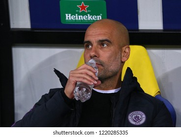 "KHARKIV, UKRAINE - OCTOBER 23, 2018: Manchester City manager Josep ""Pep"" Guardiola drinks water during the UEFA Champions League game against Shakhtar Donetsk at OSK Metalist stadium in Kharkiv"
