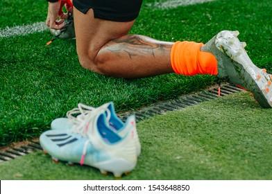 Kharkiv, Ukraine - October 27, 2019: Captain Taison Barcellos Freda legs close-up view with tattoo and Adidas boots. Ukrainian Premier League. Shakhtar Donetsk vs Olexandria