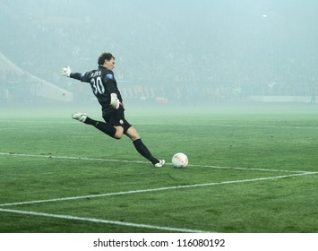 KHARKIV, UKRAINE - OCTOBER 7: FC Shakhtar Donetsk GK Andriy Pyatov in dense smoke during football match vs FC Metalist Kharkiv, October 7, 2012 in Kharkov, Ukraine