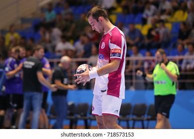 KHARKIV, UKRAINE - SEPTEMBER 14, 2017: SOROKA Igor portrait. Player stays focused looking on the ball in his hands. EHF Men's Champions League Group Phase. HC Motor - Chekhovskie Medvedi
