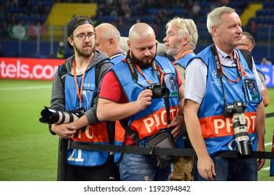 KHARKIV, UKRAINE - SEPTEMBER 19, 2018: Photojournalists and photojournalists will work during UEFA Champions League match between Shakhtar Donetsk vs TSG 1899 Hoffenheim (Germany), Ukraine