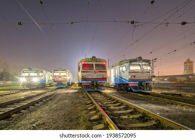 Kharkiv, Ukraine - Spring 2021: Four ER2 electric trains stand at the dead end of the station awaiting departure.  Ukrainian railways.  Evening photo