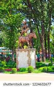 Kharkiv/Ukraine. 07 August 2016: Monument to musicians of Bremen in city park of Kharkiv. statue of Bremen Town Musicians, donkey, dog, cat and cockerel. Bremen Town Musicians: rooster, cat, dog