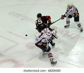 KHARKOV, UA - NOVEMBER 30: Babinets N15 downed during HC Kharkov vs. Donbass (5:8) ice hockey match, November 30, 2010 in Kharkov, Ukraine