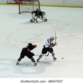 KHARKOV, UA - NOVEMBER 30: Pavel Bolshakov (R) in action during HC Kharkov vs. Donbass (5:8) ice hockey match, November 30, 2010 in Kharkov, Ukraine