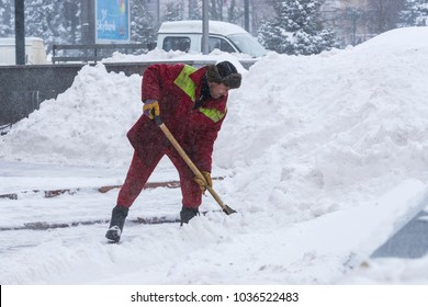 KHARKOV, UKRAINE- 1 MARCH 2018: Cleaning of the streets of the city by residents and public utilities in the period of climatic cataclysm of large snowfalls.