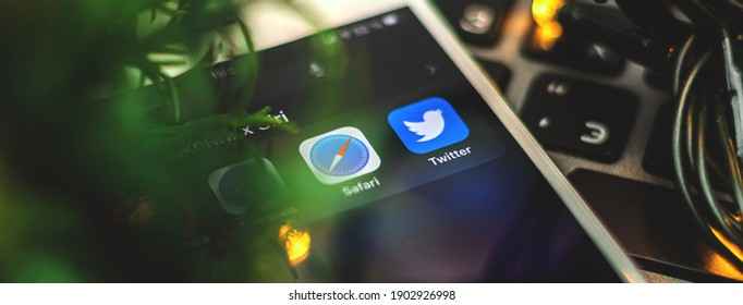 Kharkov, Ukraine - 26 January, 2021: logo of twitter and safari application on Apple iPhone, creative close up banner, workplace and copy space photo