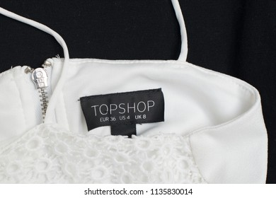 KHARKOV, UKRAINE- 29 JUNE 2018: Black tag of white clothes TOPSHOP. Close up