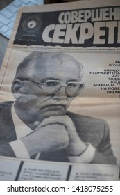 """KHARKOV, UKRAINE - 3 JUNE, 2019: The old black and white newspaper """"TOP SECRET"""" with an article with a photo of Mikhail Gorbachev winner of the Nobel Prize September 2, 1990."""