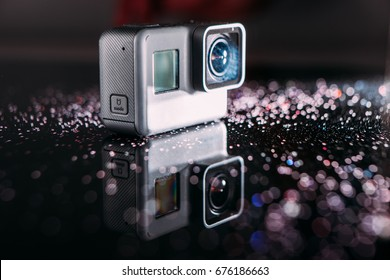Kharkov, Ukraine - April 13, 2017: GoPro HERO 5 digital action camera in spotlight with sparkles on black. Compact gadget waterproof , support 4k video and is often used in extreme photography