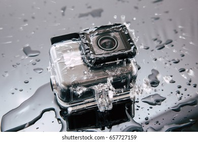 Kharkov, Ukraine - April 6, 2017: GoPro HERO 5 action camera in waterproof case under water flow. Compact gadget waterproof , support 4k video, voice controls and is often used in extreme photography