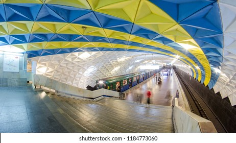KHARKOV, UKRAINE - CIRCA JULY 2016: An underground train departing from Sportivna metro station on Kholodnogorska Line of Kharkiv metro timelapse hyperlapse, with a passengers on a platform, in