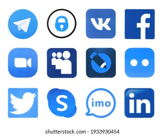 KHARKOV, UKRAINE - FEBRUARY 24, 2021: Many icons of popular social networks and messengers printed on white paper. Logos of modern communication portals and smartphone apps.