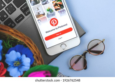 Kharkov, Ukraine - February 27, 2021: Pinterest application logo on smartphone screen, Apple iPhone with Internet social service, searching images
