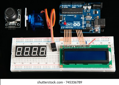 Kharkov, Ukraine - March 21, 2017: Arduino UNO board with electronic components, top view. Microcontroller for programming and prototyping with breadboard