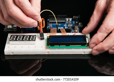 Kharkov, Ukraine - March 21, 2017: Arduino UNO board with electronic components, close up. Engineer experiment with microcontroller for programming and KYX 5461as LED display