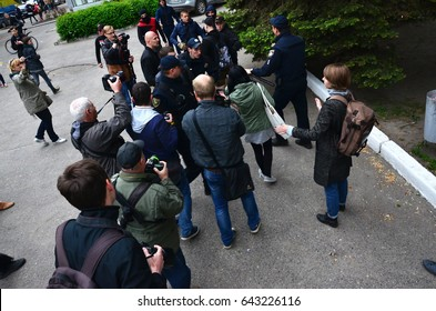 "KHARKOV, UKRAINE - MAY 17, 2017: The organization of Ukrainian Nazis and ""Eastern Corps"" patriots disrupts the first LGBT action in Kharkov. Hooligans and ultras against the existence of minorities"