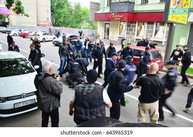 KHARKOV, UKRAINE - MAY 17, 2017: Police officers arrest Kharkiv right-wing activists who violated the law during the LGBT rally in Kharkov